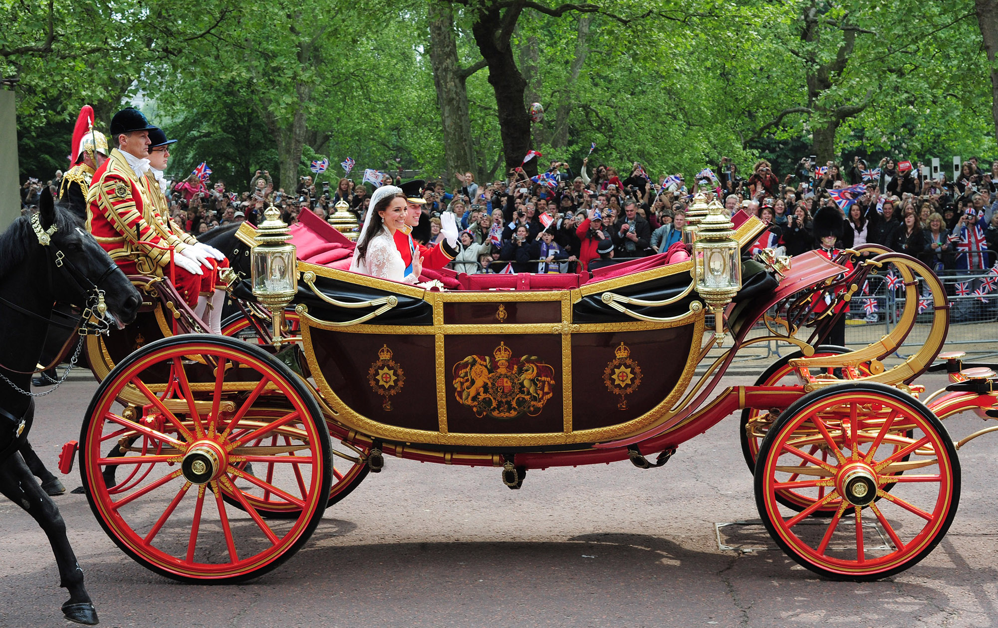 Prince William and Kate Middleton on their matrimony day carriage float in 2011.