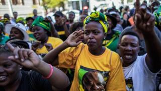 Supporters of a ANC and South Africa's new President Cyril Ramaphosa sing and dance after his irreverence in outward a South African ubiquitous open on 15 Feb 2018 in Cape Town