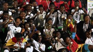 Ghana group players applaud with prize after winning a initial West African Football Union (UFOA) section B womens contest final compare between Ghana and Ivory Coast during a Parcs des Sports in Abidjan on Feb 24, 2018