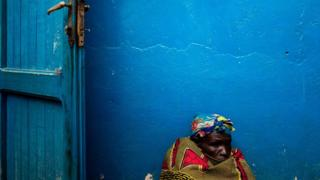 An Internally Displaced Congolese lady sits on a belligerent out side a stay for a Internally replaced on Feb 27, 2018 in Bunia,