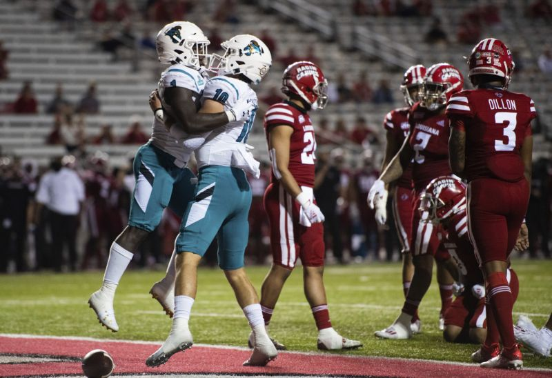 Coastal Carolina using behind CJ Marable (1) and quarterback Grayson McCall (10) applaud after Marable scored a touchdown during a initial half of an NCAA football diversion opposite Louisiana-Lafayette in Lafayette, La., Wednesday, Oct. 14, 2020. (AP Photo/Paul Kieu)