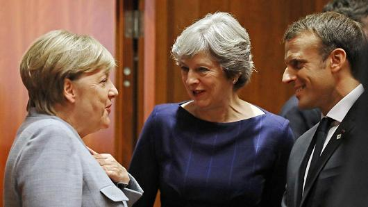 German Chancellor Angela Merkel, British PM Theresa May and French President Emmanuel Macron during Brexit talks on Oct 19, 2017 in Brussels, Belgium.