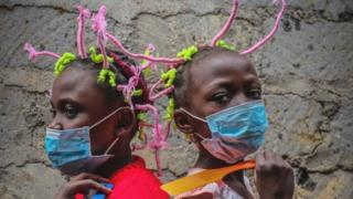 Girls in Kenya wearing masks