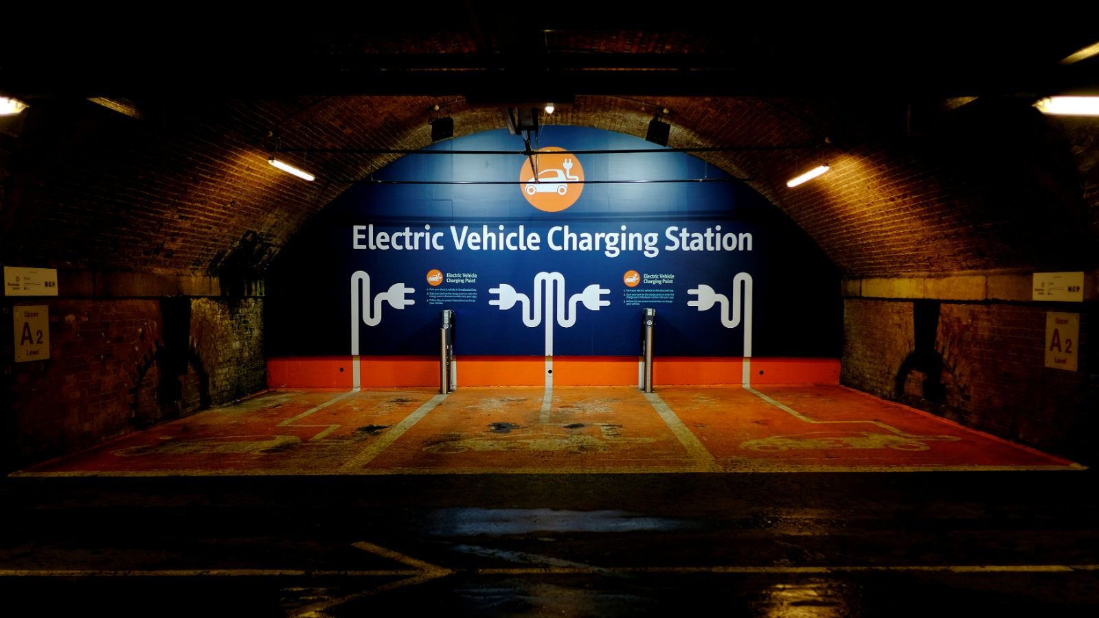 An Electric automobile charging indicate is seen in a automobile park in Manchester, Britain, Nov 15, 2016.