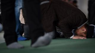 A male prays during a Baitul Futuh Mosque of Britain's Ahmadiyya Muslim village in Morden in south London