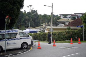 A military thong during a highway heading to former primary apportion Najib Razak's private chateau in a Taman Duta area of Kuala Lumpur. Police pronounced they were there to guard security.