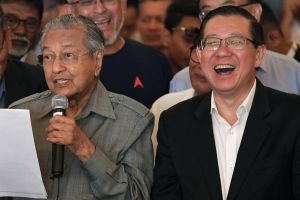 Malaysian Prime Minister Mahathir Mohamad (left) and Finance Minister Lim Guan Eng attending a press discussion during a Sheraton Petaling Jaya Hotel on May 10, 2018.