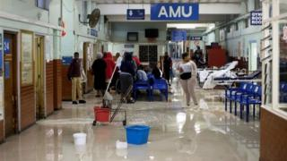 Cleaners mop adult H2O during King Edward VIII Hospital during a charge in Durban, South Africa, 10 Oct 2017
