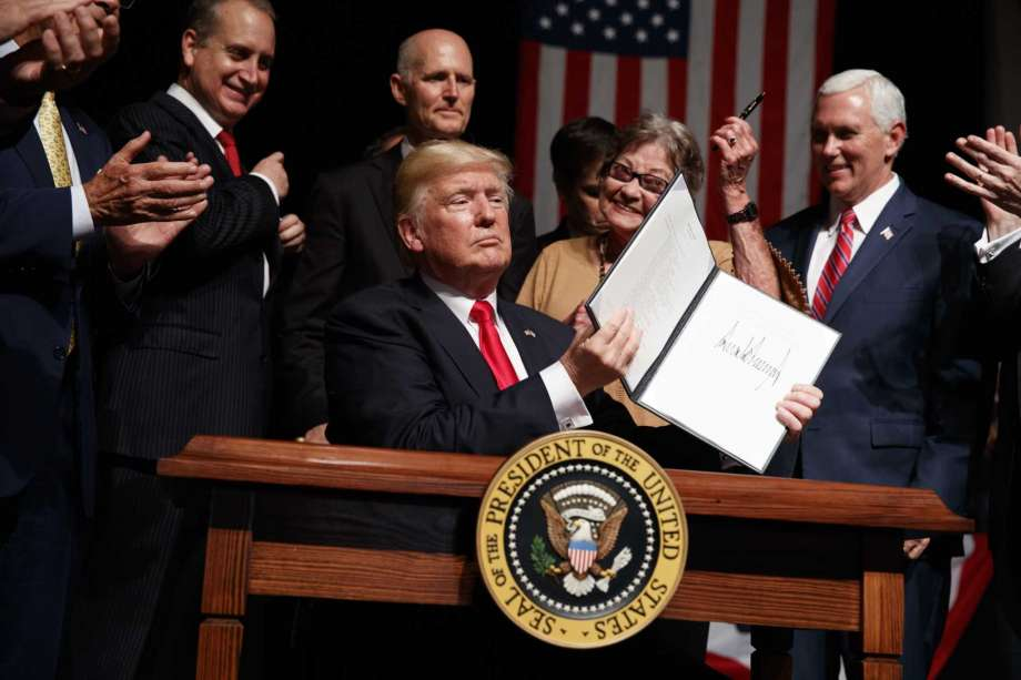 President Donald Trump shows a sealed executive sequence on Cuba policy, Friday, Jun 16, 2017, in Miami. From left are, Rep, Mario Diaz-Balart, R-Fla., Florida Gov. Rock Scott, Cary Roque, and Vice President Mike Pence. Photo: Evan Vucci, AP / Copyright 2017 The Associated Press. All rights reserved.