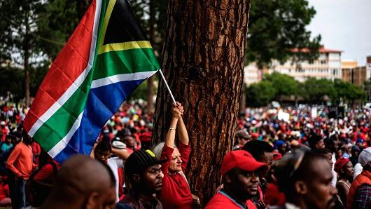 A lady waves a South African dwindle during a proof in Pretoria, job for boss Jacob Zuma to resign, in Apr 2017