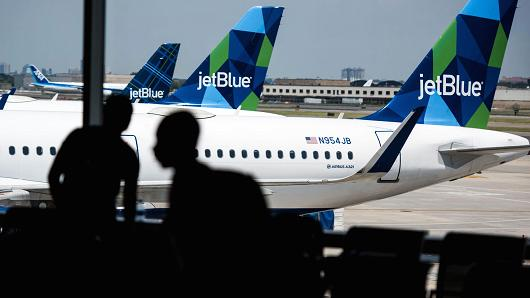 JetBlue planes during a embankment during John F. Kennedy International Airport in New York.