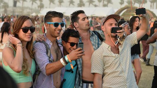 Music fans take selfies during day 2 of a 2014 Coachella Valley Music  Arts Festival during a Empire Polo Club on Apr 12, 2014 in Indio, California.