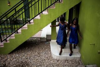 Two immature women are seen forward of a welcoming rite for initial year students on Feb 3, 2018 in Beni.