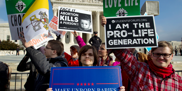 Anti-abortion activists criticism outward of a U.S. Supreme Court, during a Mar for Life in Washington final month. (AP Photo/Jose Luis Magana, File)