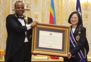 Swaziland comprehensive Monarch King Mswati III (L) poses with Taiwan President Tsai Ing-wen (R) after awarding her with a Order of a Elephant during her revisit to a Kingdom of Swaziland during an central rite on Apr 18, 2018 in Lozitha Palace, Manzini.