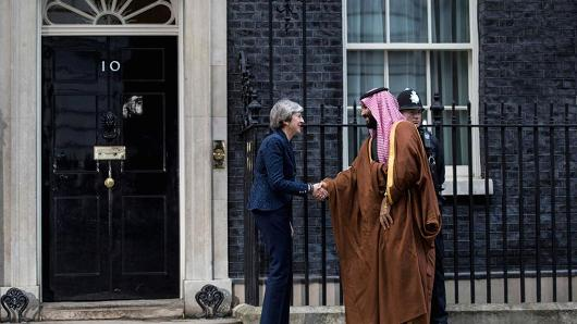 Saudi Crown Prince Mohammed bin Salman shakes hands with British Prime Minister Theresa May on a stairs of array 10 Downing Street on Mar 7, 2018 in London, England.