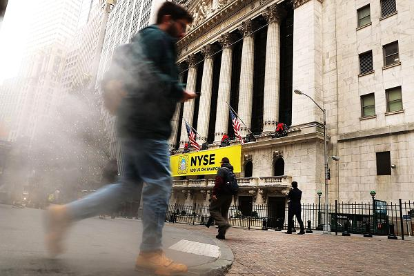 People travel outward of a New York Stock Exchange in New York City.