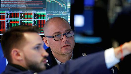 Traders work on a building of a New York Stock Exchange (NYSE) in New York.