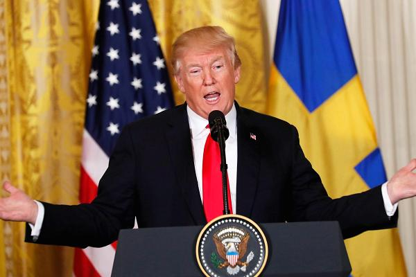 President Donald Trump addresses a corner news discussion with Sweden's Prime Minister Stefan Lofven in a East Room of a White House in Washington, Mar 6, 2018.