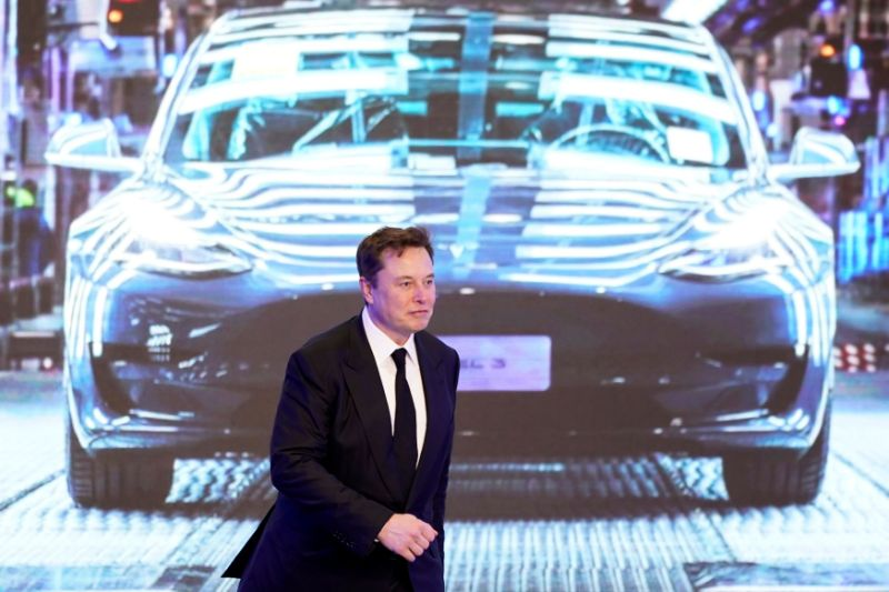 Tesla Inc CEO Elon Musk walks subsequent to a shade display an picture of Tesla Model 3 automobile during an opening rite for Tesla China-made Model Y module in Shanghai, China Jan 7, 2020. REUTERS/Aly Song