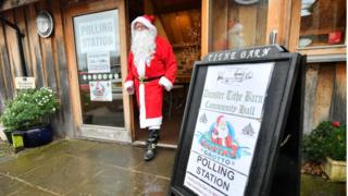 Man dressed as Father Christmas during polling hire in Somerset