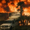 'Out of control' Southern California glow explodes as flourishing blazes force tens of thousands to flee