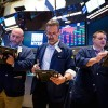 Dow jumps some-more than 300 points after banks rebound; tiny caps strike new record