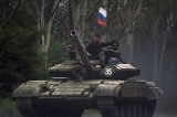 Cameron to check arms trade licences to Russia