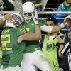 Oregon wins Pac-12 title, assures place in football playoff