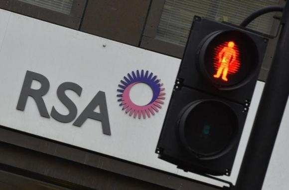 A sign of RSA insurance company is pictured outside its office in London